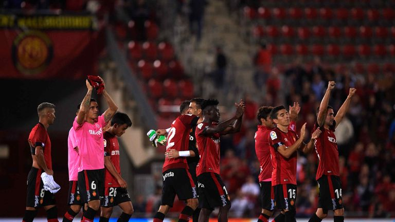 Real Mallorca's players celebrated wildly at the final whistle