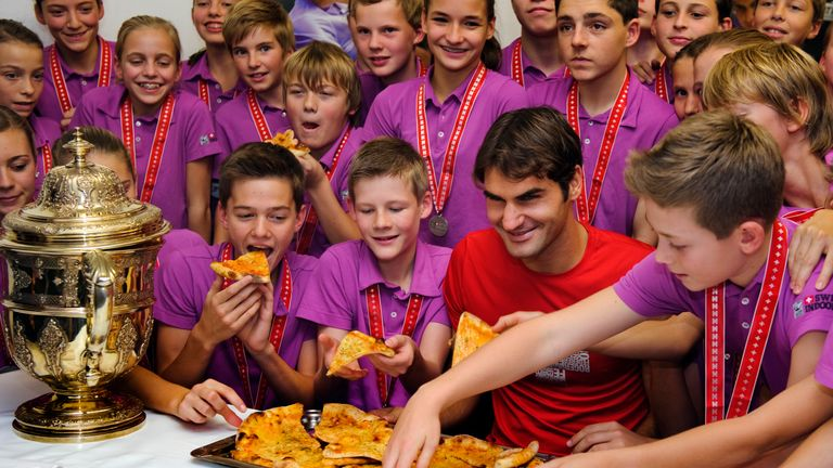 It is now tradition for Federer to get the pizza in for the ball kids to devour