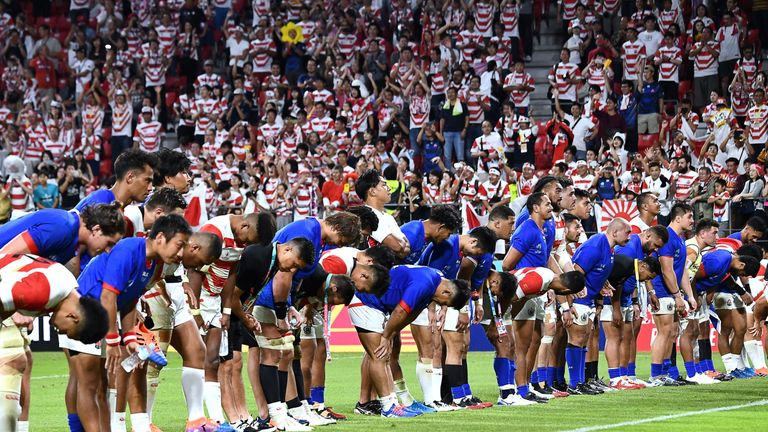 Japan and Samoa players bow after their Rugby World Cup match