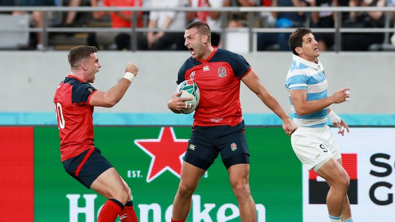 George Ford (L) celebrates after Jonny May scores his try