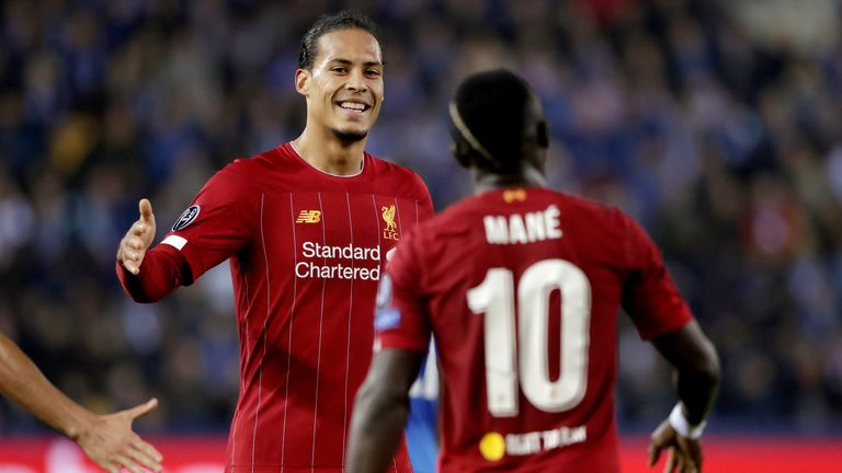 Sadio Mane celebrates with Virgil van Dijk after scoring against Genk