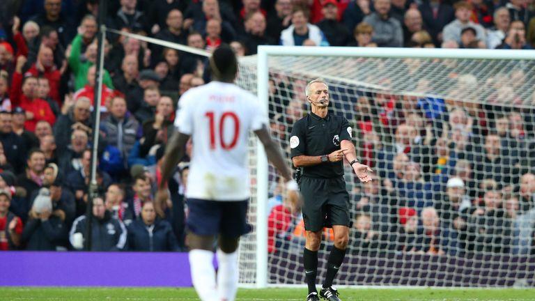 Martin Atkinson signals handball after VAR rules out Sadio Mane's goal