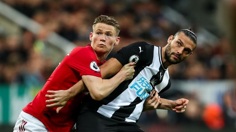Scott McTominay grapples with Andy Carroll