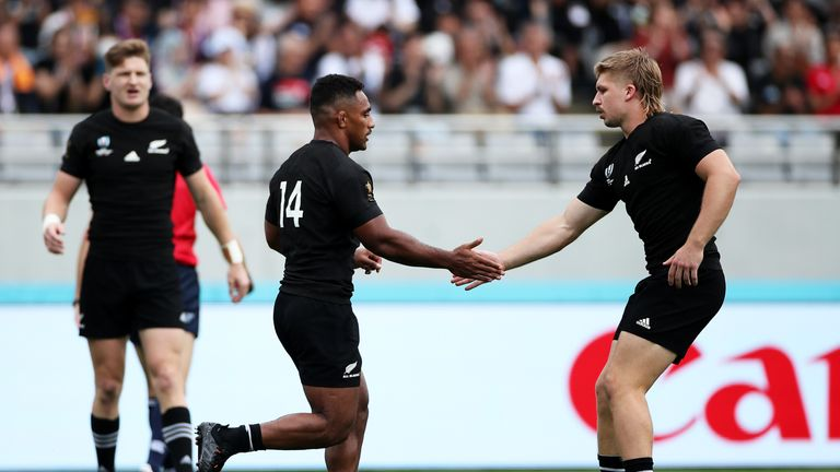 Sevu Reece of New Zealand is congratulated by his team mate Jack Goodhue after scoring his side's first try during the Rugby World Cup 2019 Group B game between New Zealand and Namibia at Tokyo Stadium on October 06, 2019 in Chofu, Tokyo, Japan.