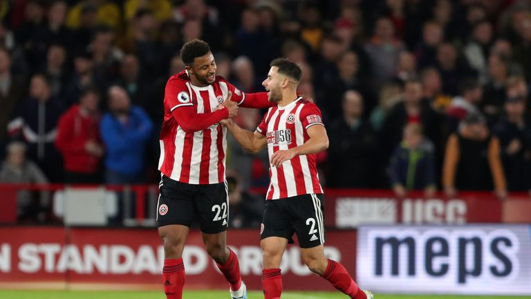 SHEFFIELD, ENGLAND - OCTOBER 21: Lys Mousset of Sheffield United celebrates after scoring a goal to make it 1-0 with George Baldock during the Premier League match between Sheffield United and Arsenal FC at Bramall Lane on October 21, 2019 in Sheffield, United Kingdom. (Photo by James Williamson - AMA/Getty Images)