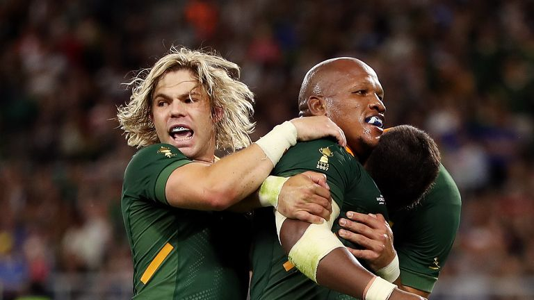 Mbongeni Mbonambi of South Africa celebrates after scoring his team's second try
