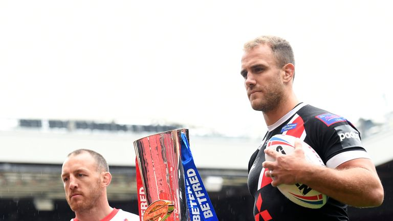 St Helens and Salford captains James Roby and Lee Mossop with the Super League trophy