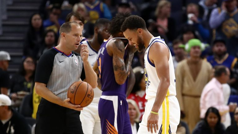 Stephen Curry of the Golden State Warriors grimaces after he was injured in the second half of their game against the Phoenix Suns