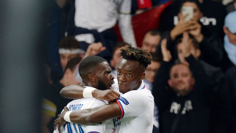 Chelsea's Tammy Abraham celebrates with team-mate Fikayo Tomori after scoring a against Lille