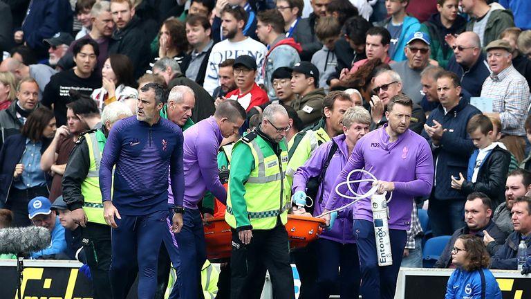 Tottenham goalkeeper Hugo Lloris is carried off against Brighton