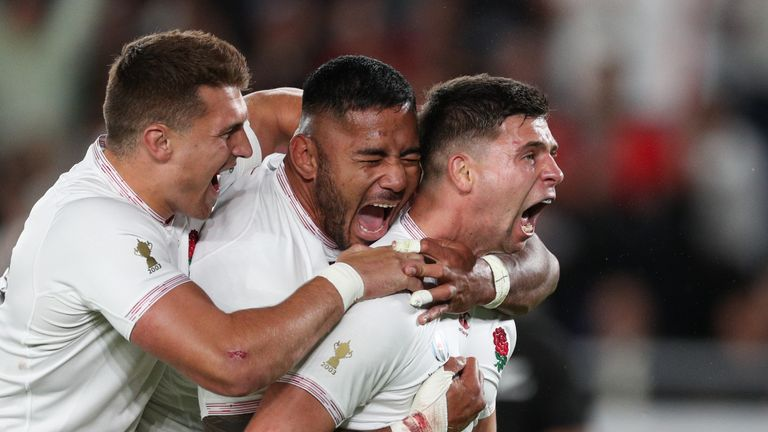 Manu Tuilagi (middle) scored England's only try as a wonderful team performance earned a Rugby World Cup final place