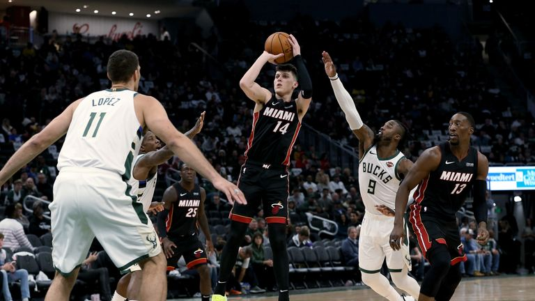 Tyler Herro of the Miami Heat attempts a shot in the third quarter against the Milwaukee Bucks