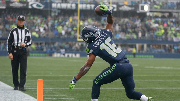 Tyler Lockett spikes the ball after scoring a touchdown