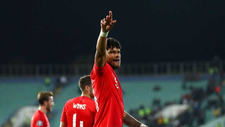 Tyrone Mings acknowledges England supporters following England's 6-0 win over Bulgaria in Sofia