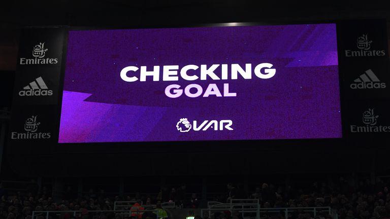 Caption of VAR checking the goal