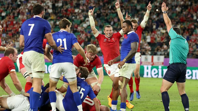 Wales left it late to beat 14-man France and seal a third ever Rugby World Cup semi-final place