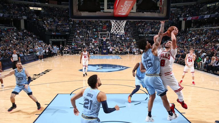 Zach LaVine of the Chicago Bulls shoots the ball against Brandon Clarke of the Memphis Grizzlies