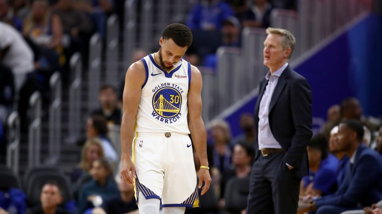 A dejected Stephen Curry and head coach Steve Kerr pictured during the Warriors' heavy loss to the LA Clippers
