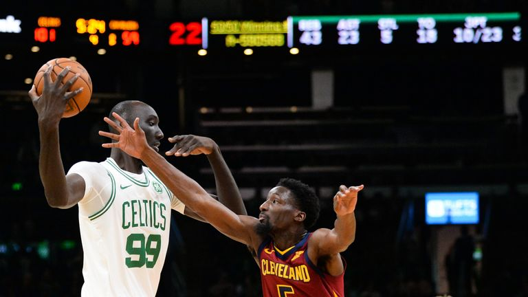 Tacko Fall shields the ball from a Cavaliers defender