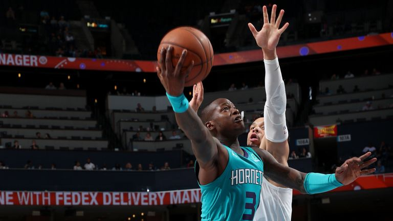 Terry Rozier scores with a lay-up against Memphis