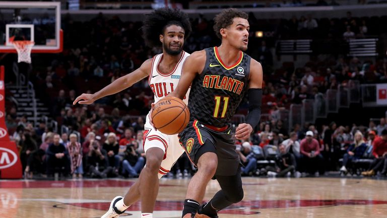 Trae Young evades the attention of Coby White