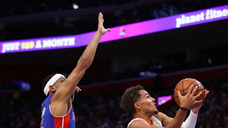 Trae Young attacks the rim against the Detroit Pistons