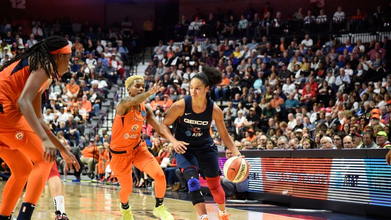 Kristi Toliver handles the ball while guarded by Courtney Williams