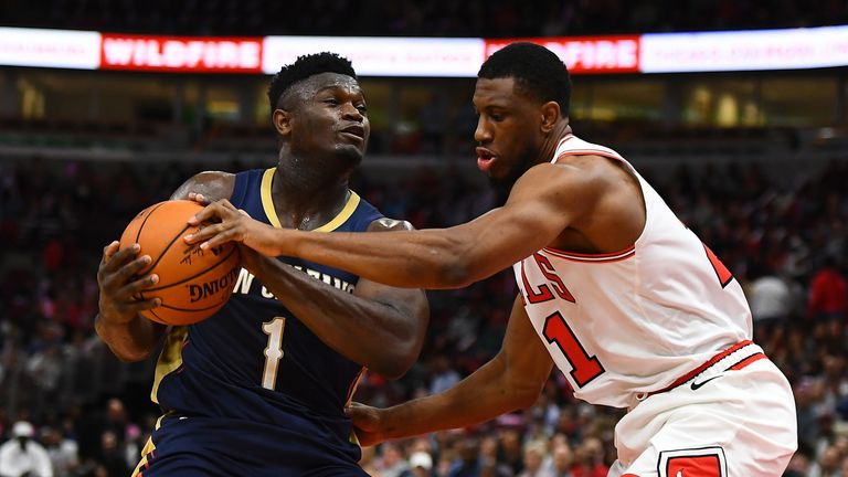 Zion Williamson protects the ball from the Chicago Bulls' defense