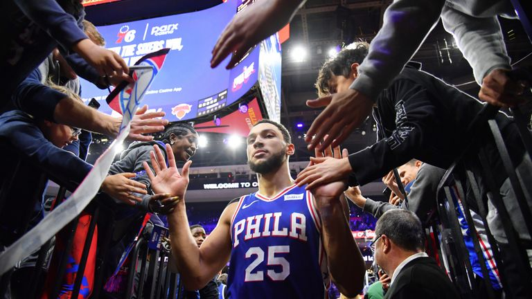 Ben Simmons high-fives Sixers fans following Philadelphia's win over the New York Knicks