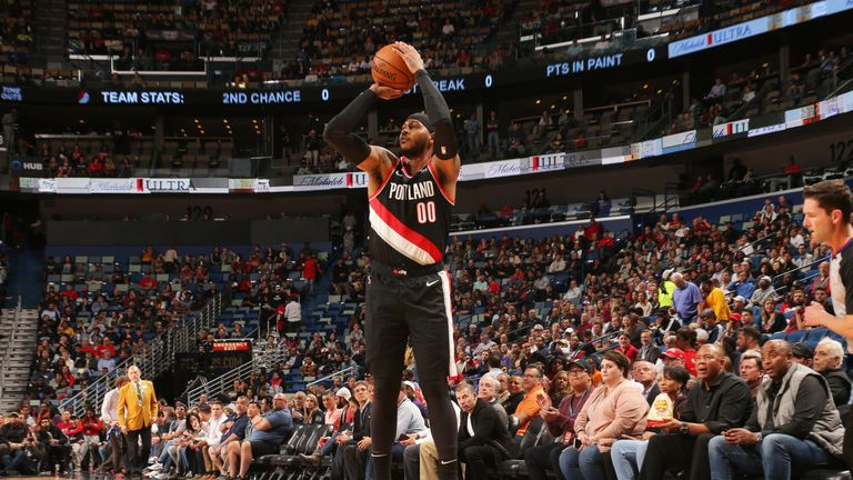 Carmelo Anthony shoots a three-pointer during his Portland debut