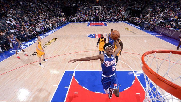 De'Aaron Fox elevates for a dunk against the Utah Jazz