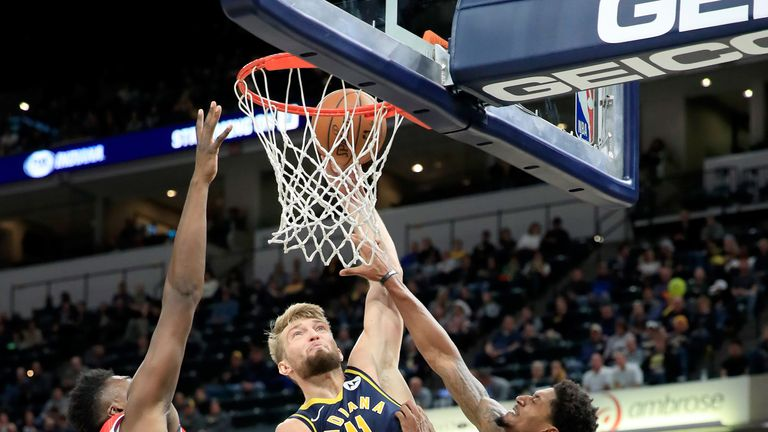Domantas Sabonis finishes at the rim against the Wizards
