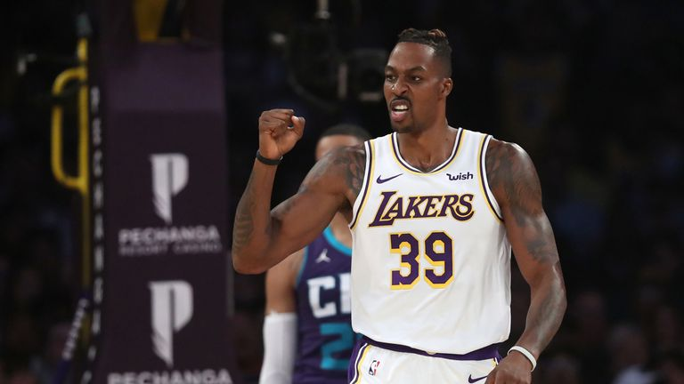 Dwight Howard celebrates a successful Lakers play against the Charlotte Hornets