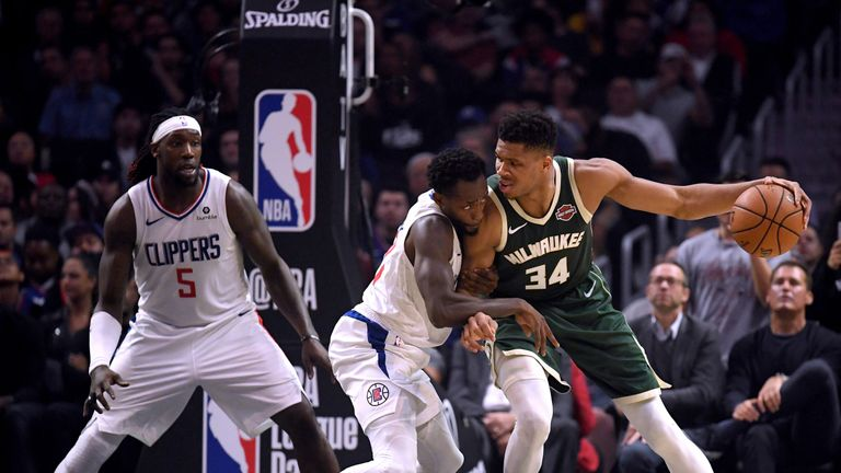 Giannis Antetokounmpo backs down Patrick Beverley