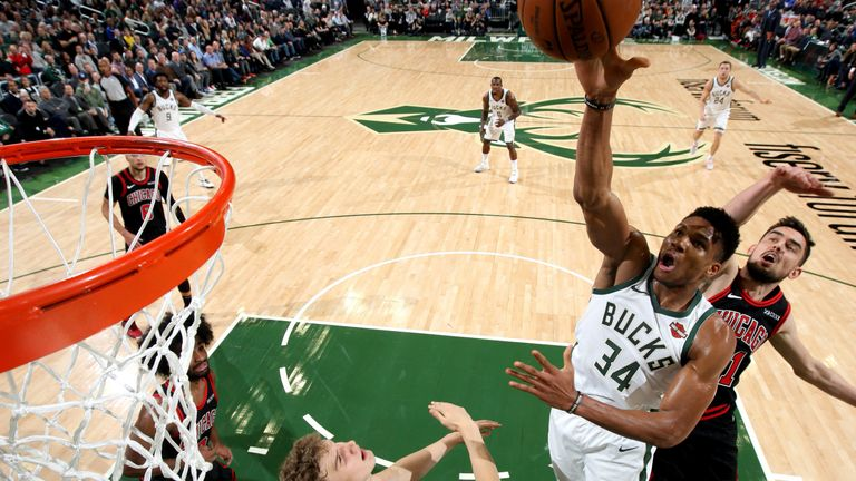 Giannis Antetokounmpo finishes at the rim against the Bulls