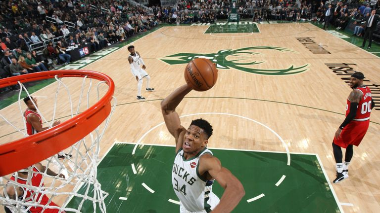 Giannis Antetokounmpo rises for a right-handed dunk against Portland