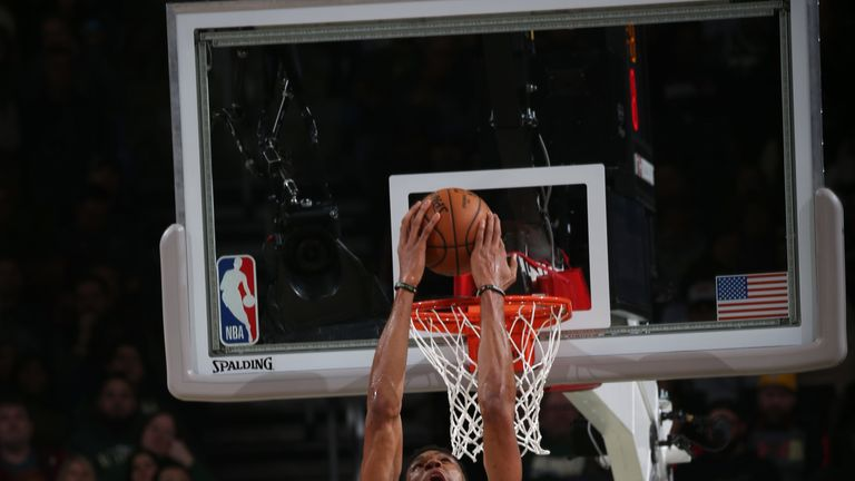 Giannis Antetokounmpo powers home a reverse dunk against the Trail Blazers