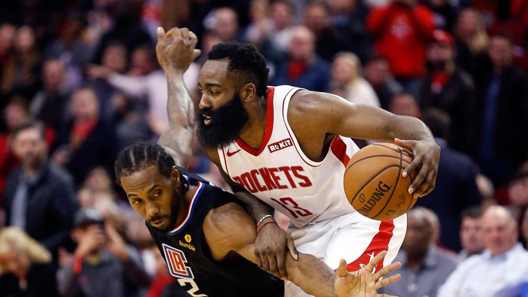 Kawhi Leonard attempts to steal possession from James Harden