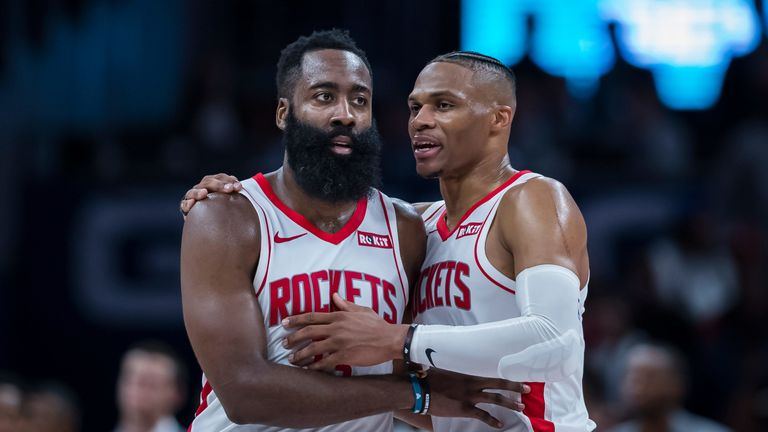 James Harden and Russell Westbrook share a word during a Rockets game