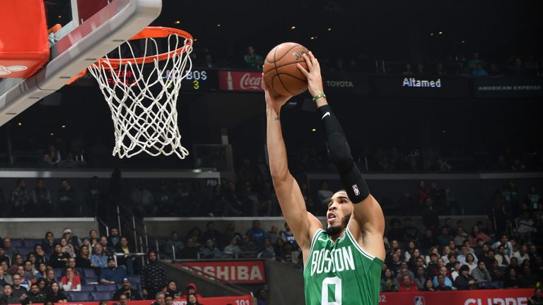Jayson Tatum skies for a dunk against the Clippers