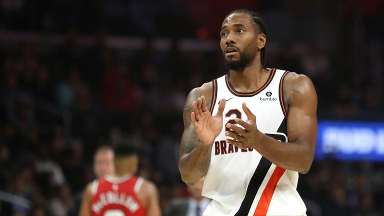 Kawhi Leonard applauds his team-mates during the Clippers' victory over the Trail Blazers.