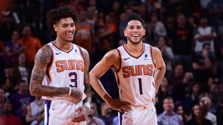 Kelly Oubre Jr and Devin Booker pictured in good spirits during a Phoenix Suns game