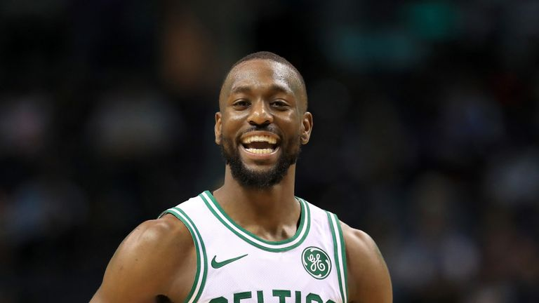 Kemba Walker reacts after receiving a warm welcome on his return to Charlotte