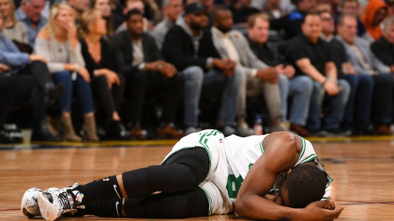 Kemba Walker lays on the court after colliding with team-mate Semi Ojeleye