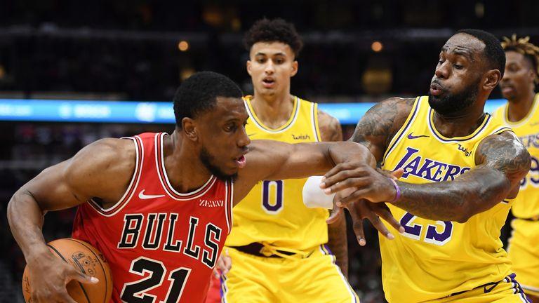 LeBron James grapples for possession against the Chicago Bulls