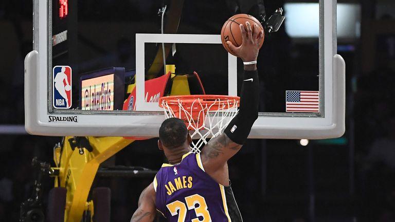 LeBron James posterizes Nemanja Bjelica with a thunderous dunk