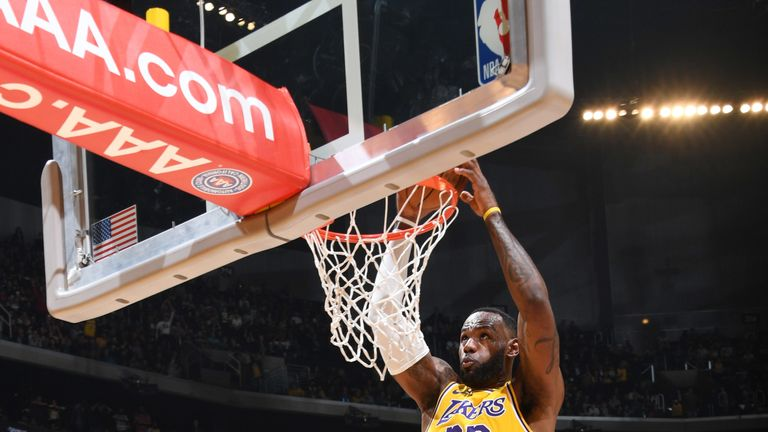 LeBron James dunks in the Lakers' win over the Thunder