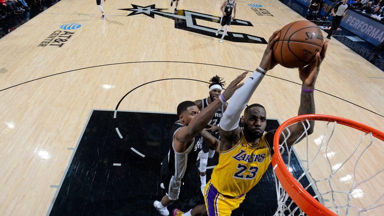 LeBron James dunks against the San Antonio Spurs
