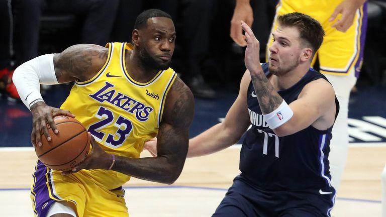 LeBron James drives against Luka Doncic
