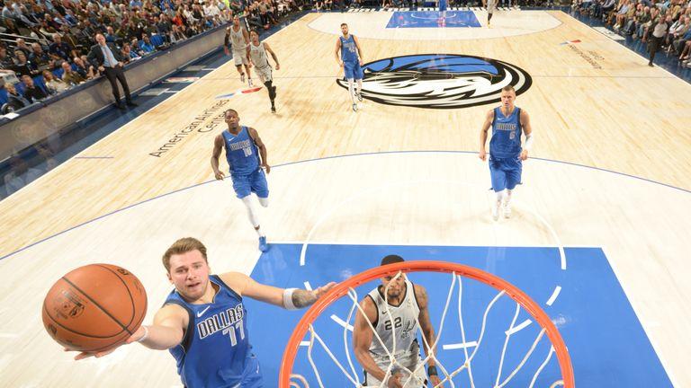 Luka Doncic scores at the rim against the Dallas Mavericks